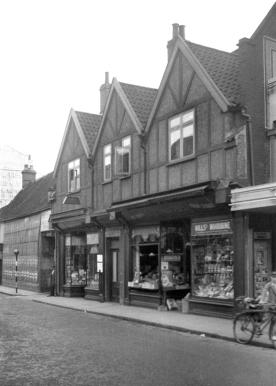 Shops fronts on Magdalen Street (1938)