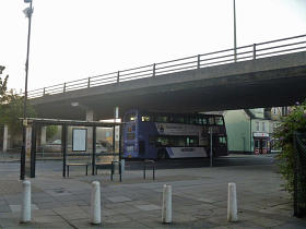 A image of the Magdalen Street Flyover with a bus driving under it.